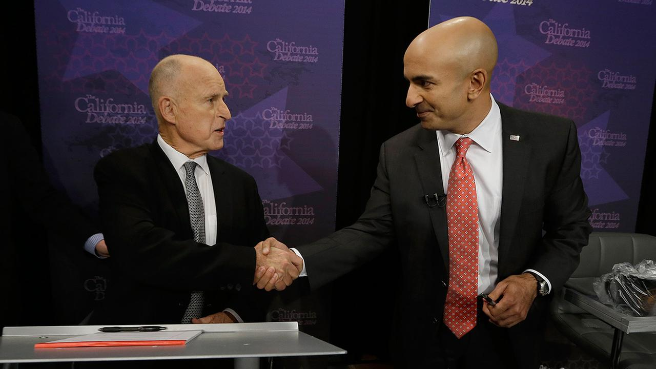 Gov. Jerry Brown, left, shakes hands with Republican challenger Neel Kashkari before a gubernatorial debate in Sacramento, Calif., Thursday, Sept. 4, 2014.