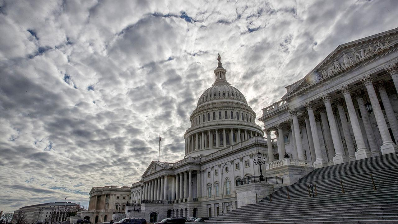 The Capitol is seen under cloudy skies on Day 2 of the federal shutdown, in Washington, Sunday, Jan. 21, 2018.