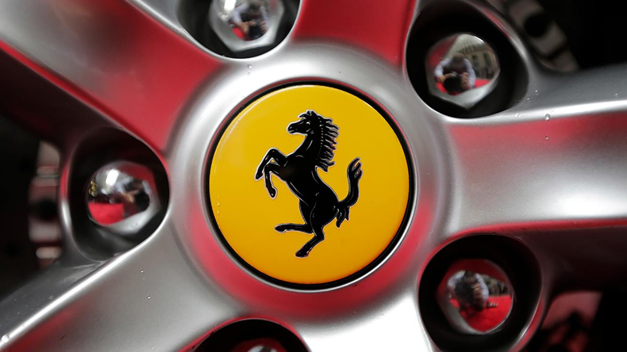 A Ferrari logo is seen on a car outside the New York Stock Exchange in New York, Monday, Oct. 9, 2017. Ferrari is celebrating its 70th anniversary.