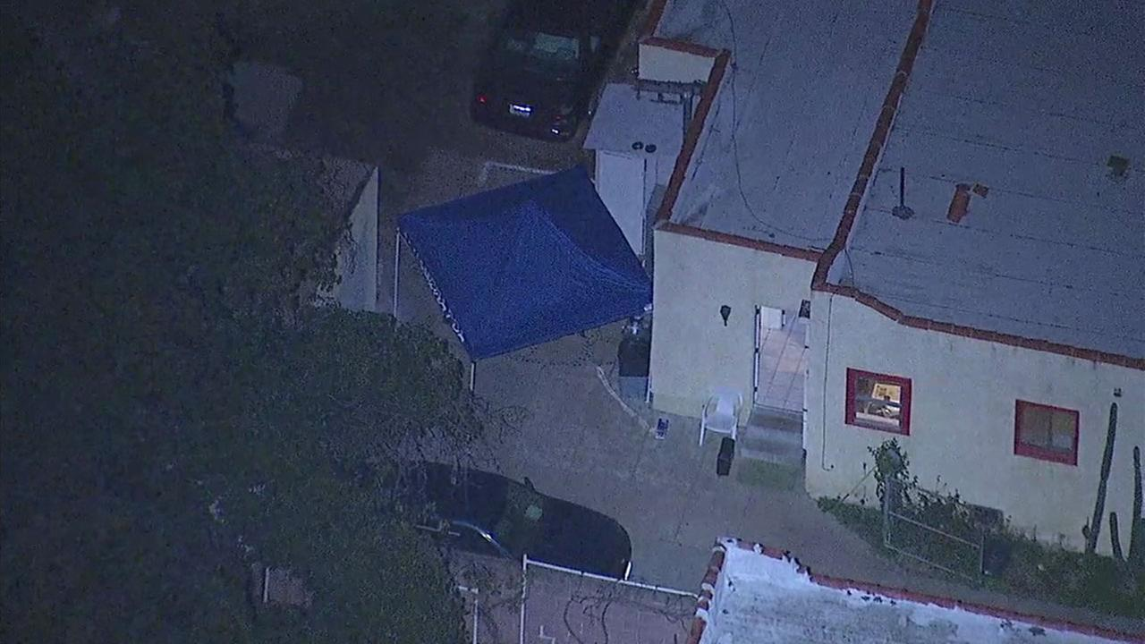 A tent was set up over an area where a womans body was found in the backyard of an Alhambra home on Thursday, Jan. 25, 2018.