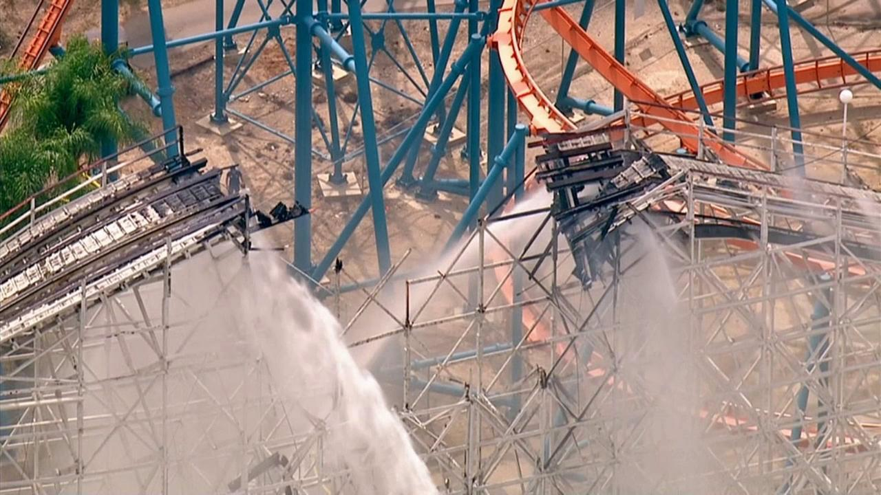 A fire broke out while workers were disassembling the recently closed Colossus ride at Six Flags Magic Mountain on Monday, Sept. 8, 2014, causing part of the famous wooden roller coaster to collapse.