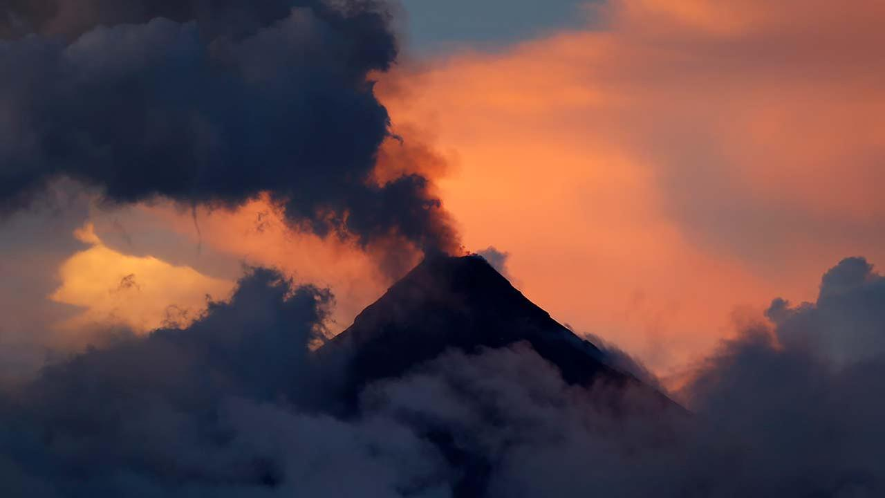 Mayon volcano emits ash during its eruption at sunset, as seen from Legazpi city, Albay province around 200 miles southeast of Manila, Philippines, Friday, Jan. 26, 2018.