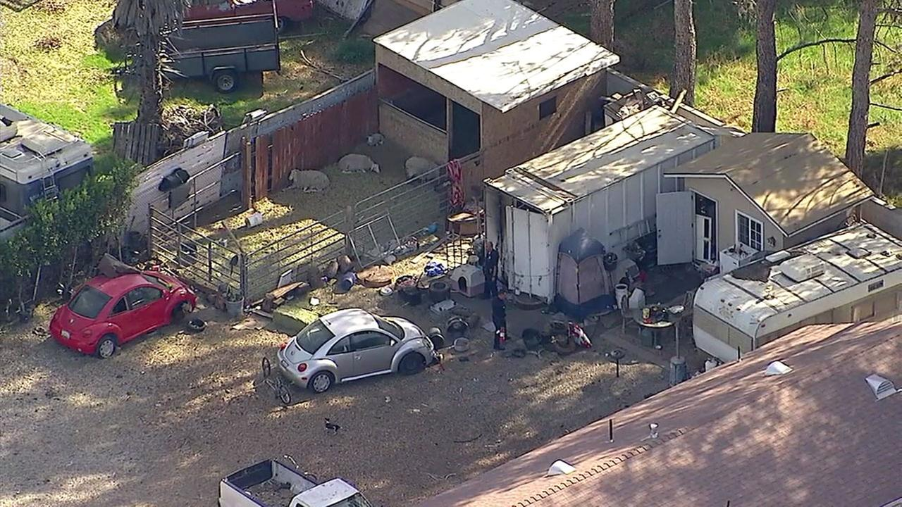 Authorities surrounded a storage container in the back of a property in Winnetka where a womans body was found on Monday, Jan. 29, 2018.