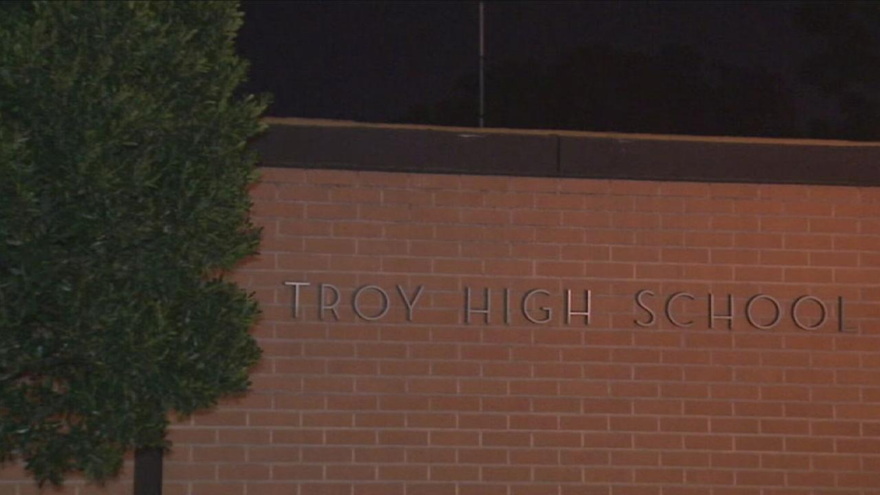 A 15-year-old girl has been arrested in connection with alleged threats of violence made toward Troy High School in Fullerton, police said.