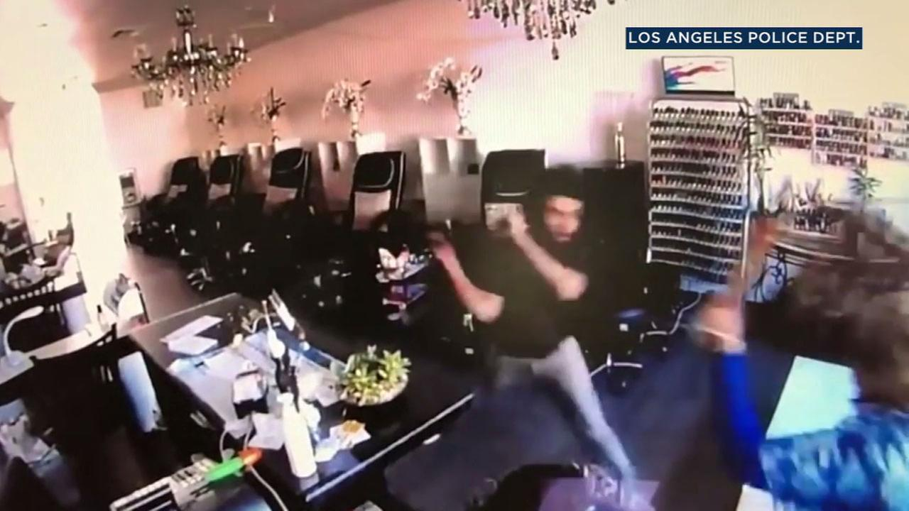 Two women were seen on video fighting back against a man who randomly attacked them shortly after carjacking a vehicle in Van Nuys.