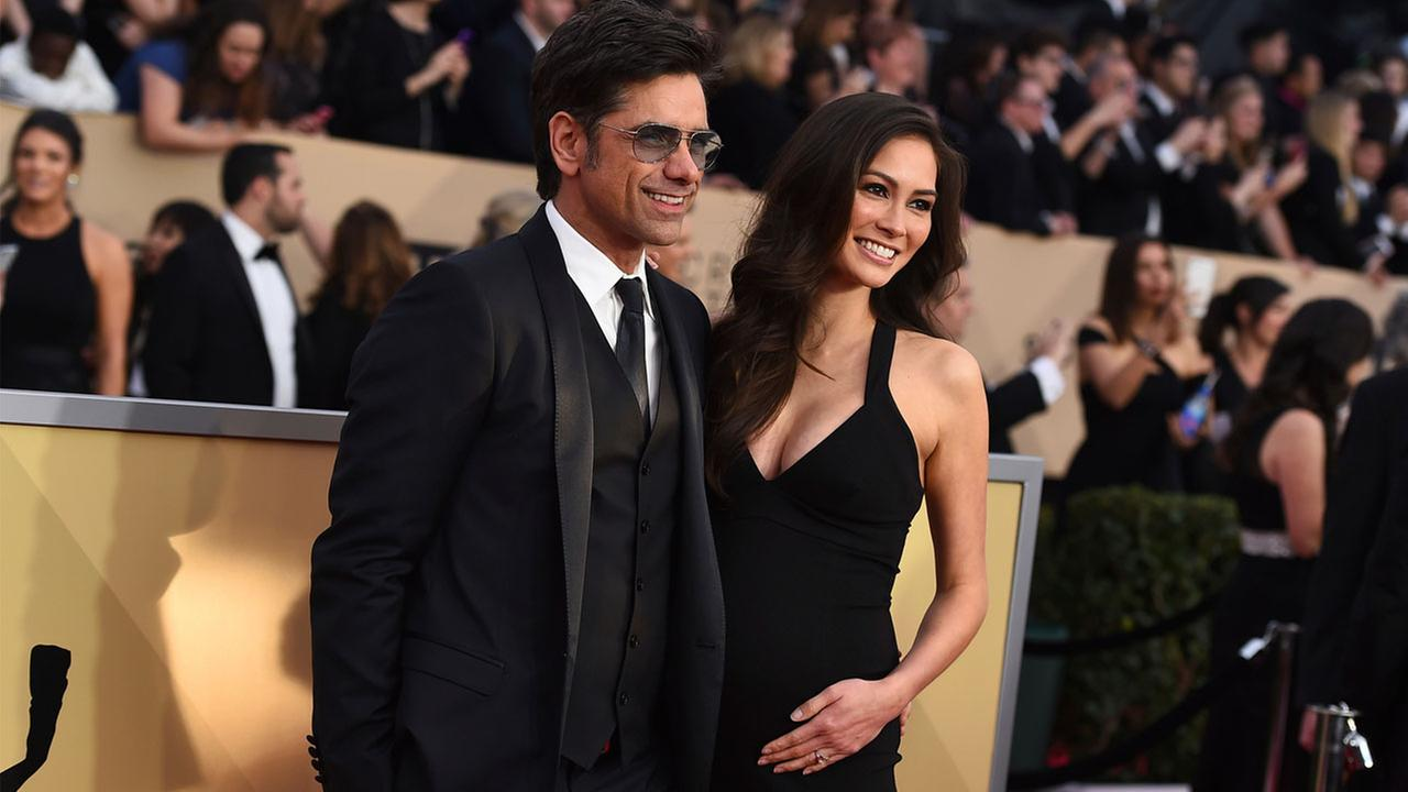 John Stamos, left, and Caitlin McHugh arrive at the 24th annual Screen Actors Guild Awards at the Shrine Auditorium and Expo Hall on Sunday, Jan. 21, 2018.