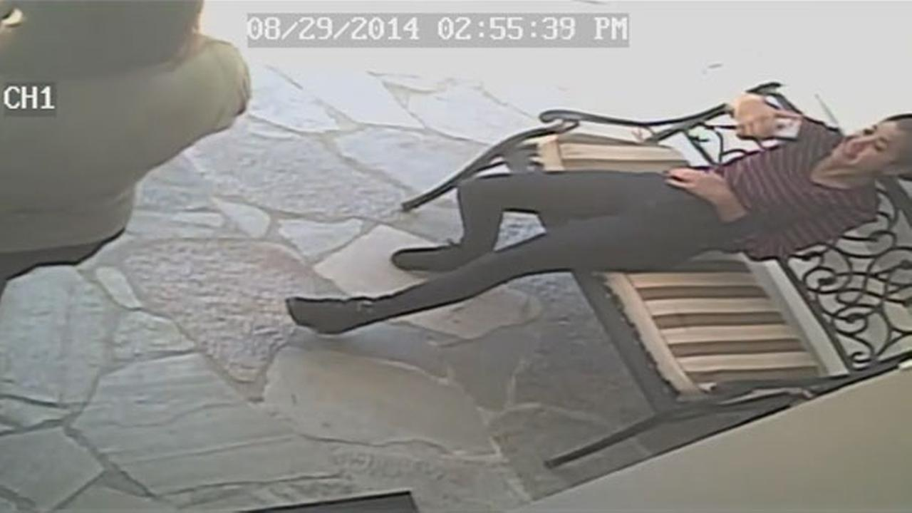 A burglary suspect is seen in surveillance video taking a selfie outside a Bel Air home on Aug. 29, 2014.