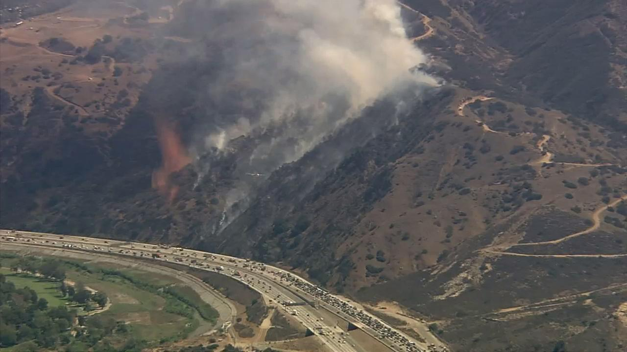 A brush fire erupted along the 91 Freeway in Corona on Wednesday, Sept. 10, 2014.