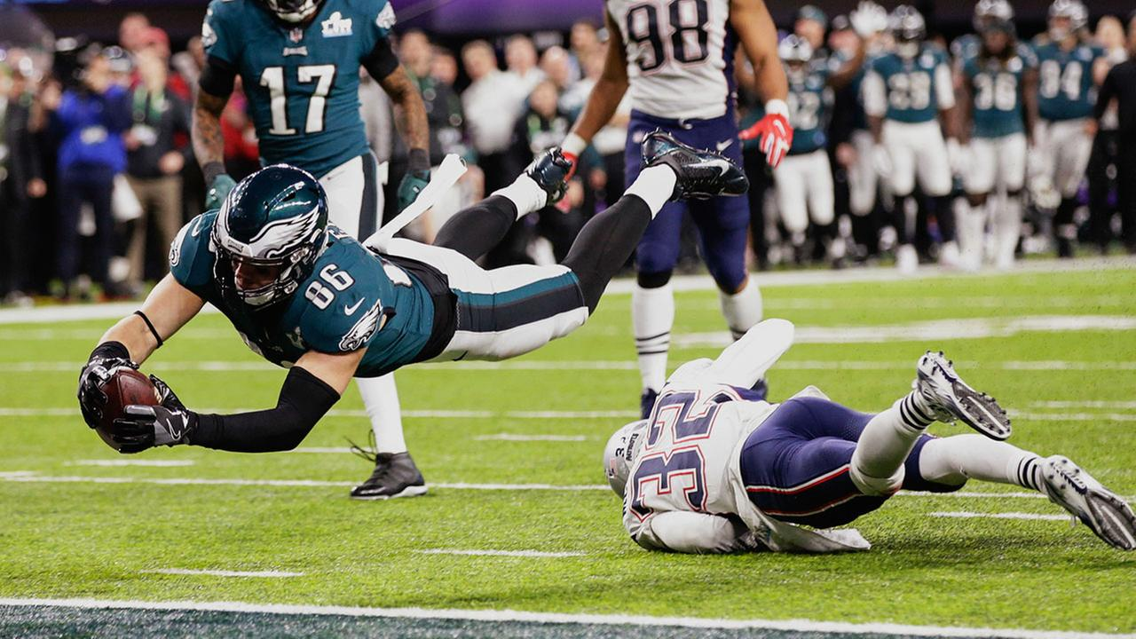 Philadelphia Eagles tight end Zach Ertz (86) dives into the end zone over New England Patriots free safety Devin McCourty (32) during Super Bowl 52 Sunday, Feb. 4, 2018.