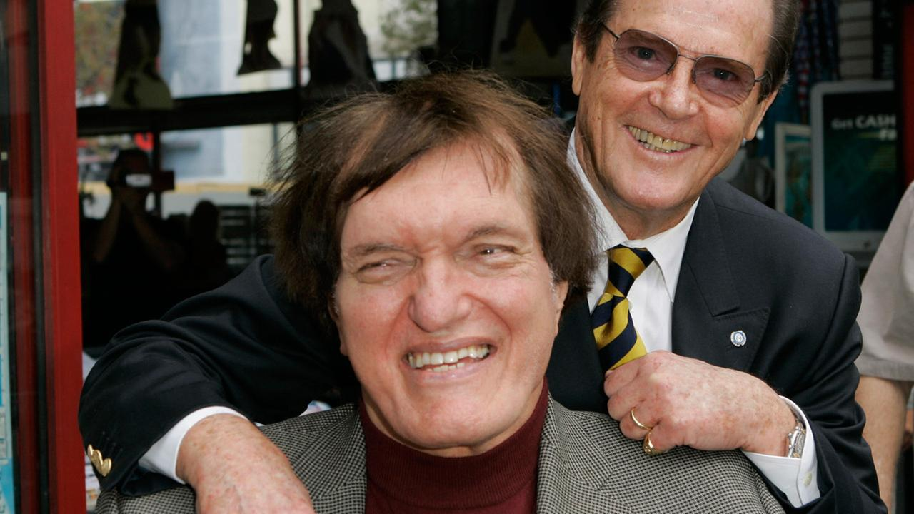 In this Oct. 11, 2007 file photo, actor Roger Moore, right, who played the part of James Bond, poses with actor Richard Kiel who played the role of Jaws in The Spy Who Loved Me.AP Photo/Mark J. Terrill, file