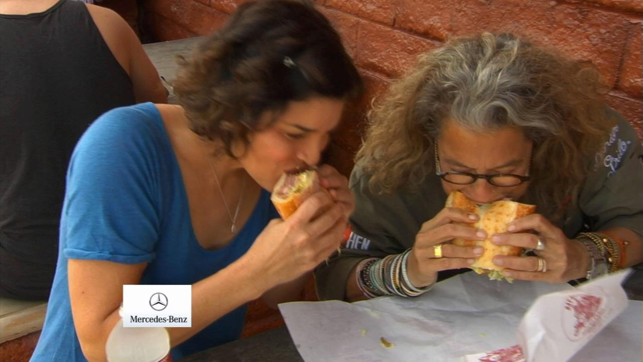 Chef Susan Feniger enjoys a sandwich with Eye on L.A. host Tina Malave at Bay Cities Italian Deli.