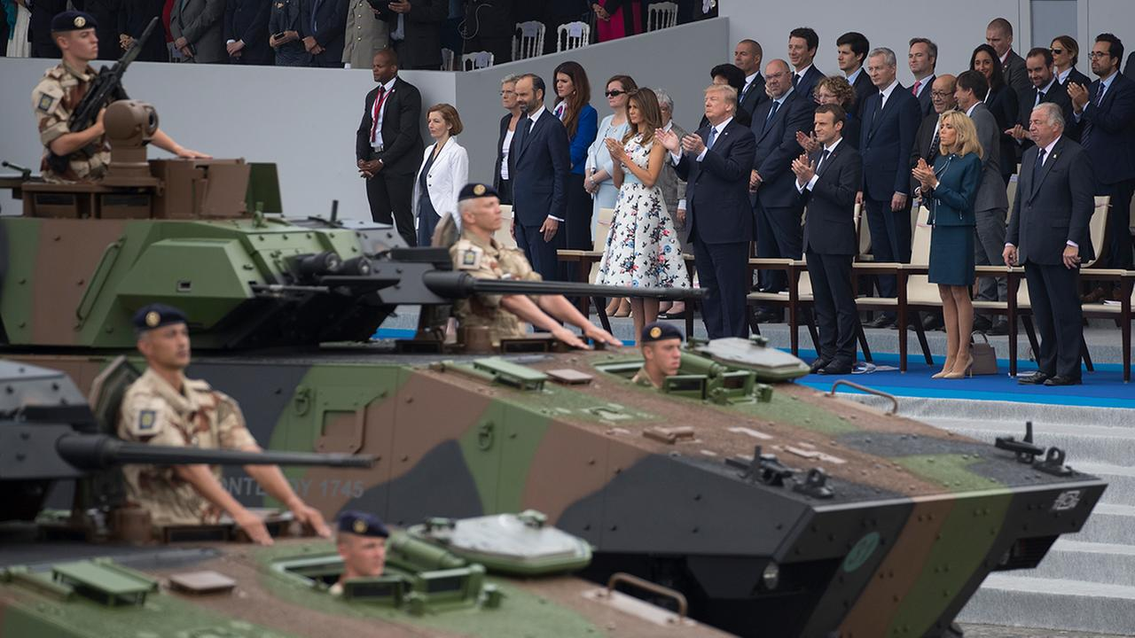 Tanks drive past President Donald Trump, first lady Melania Trump, French President Emmanuel Macron and his wife Brigitte Macron, during a parade in Paris, Friday, July 14, 2017.