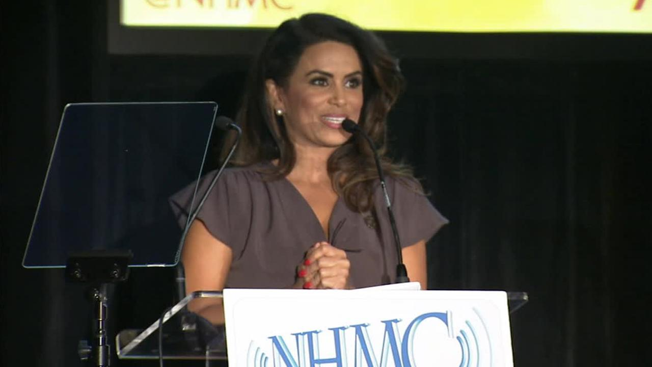 ABC7s Alysha Del Valle accepts a Local Impact Award from the National Hispanic Media Coalition, Thursday, Sept. 11, 2014.