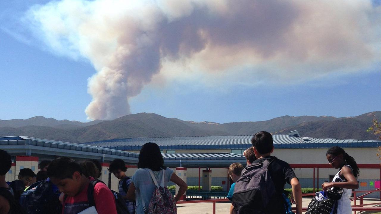 Smoke from a brush fire in Silverado Canyon is seen from Citrus Hills Intermediate School in Corona in this photo submitted by ABC7 viewer Nathan Barraza Friday, Sept. 12, 2014.
