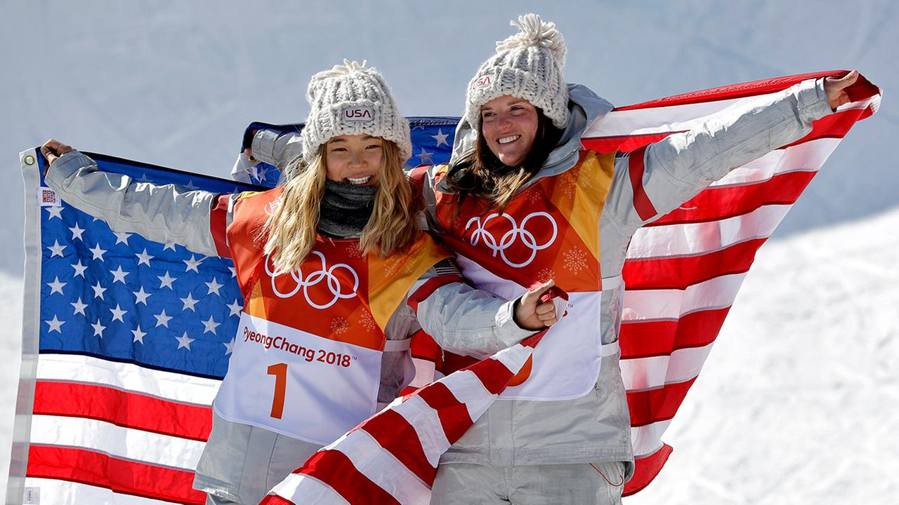 Gold winner Chloe Kim and bronze winner Arielle Gold, both of the United States, celebrate at the 2018 Winter Olympics in Pyeongchang, South Korea, Tuesday, Feb. 13, 2018.