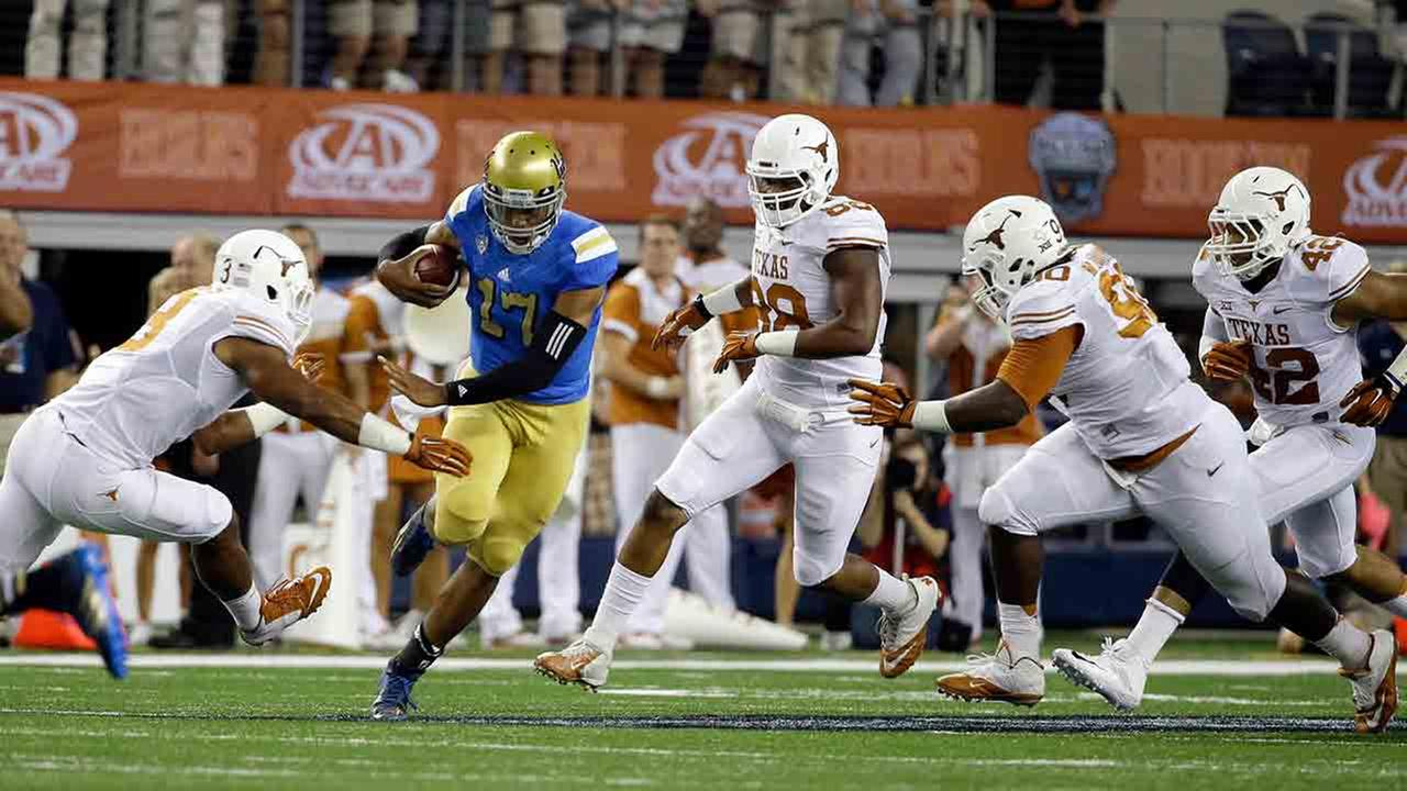 UCLA quarterback Brett Hundley (17) runs the ball against Texas during the first half of an NCAA college football game, Saturday, Sept. 13, 2014, in Arlington, Texas.