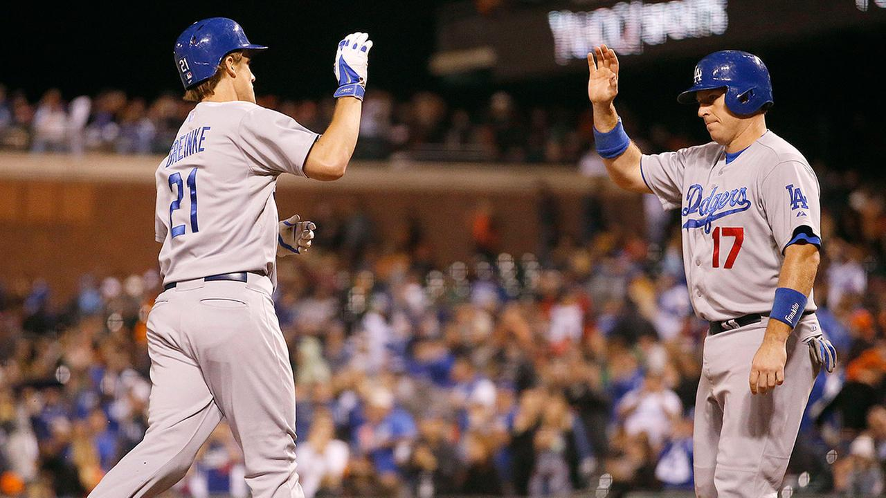 Los Angeles Dodgers Zack Greinke is congratulated by A.J. Ellis after hitting a two-run home against the San Francisco Giants during the sixth inning of a baseball game Saturday, Sept. 13, 2014, in San Francisco.