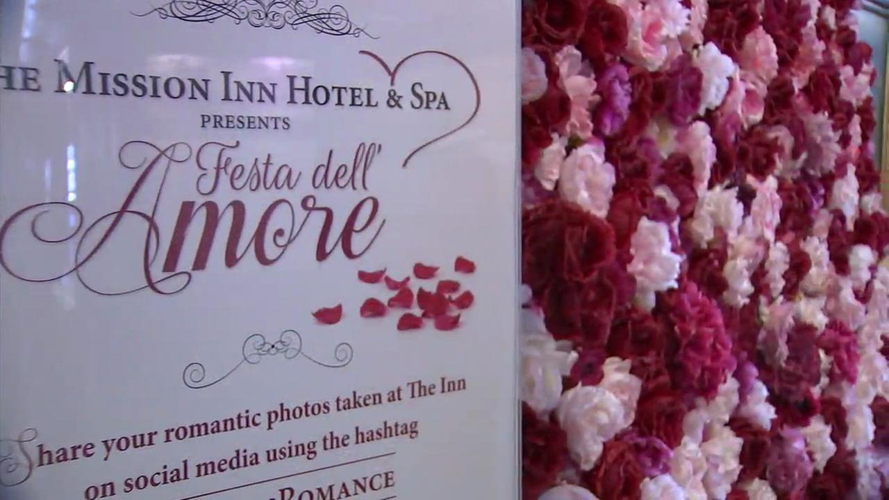 A sign decorated with flowers shows the Fest dell Amore at the Mission Inn in Riverside.