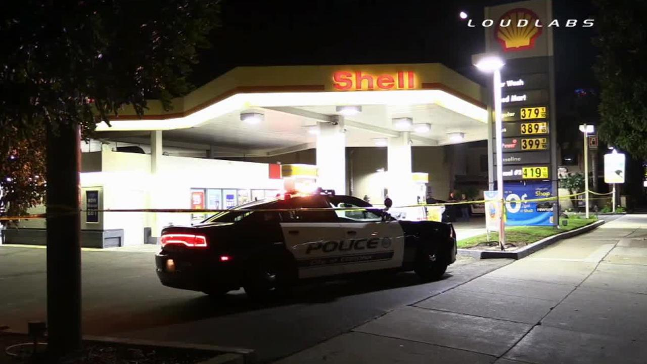 Police respond to a Shell gas station after a report about a man shot on Saturday, Sept. 13, 2014.