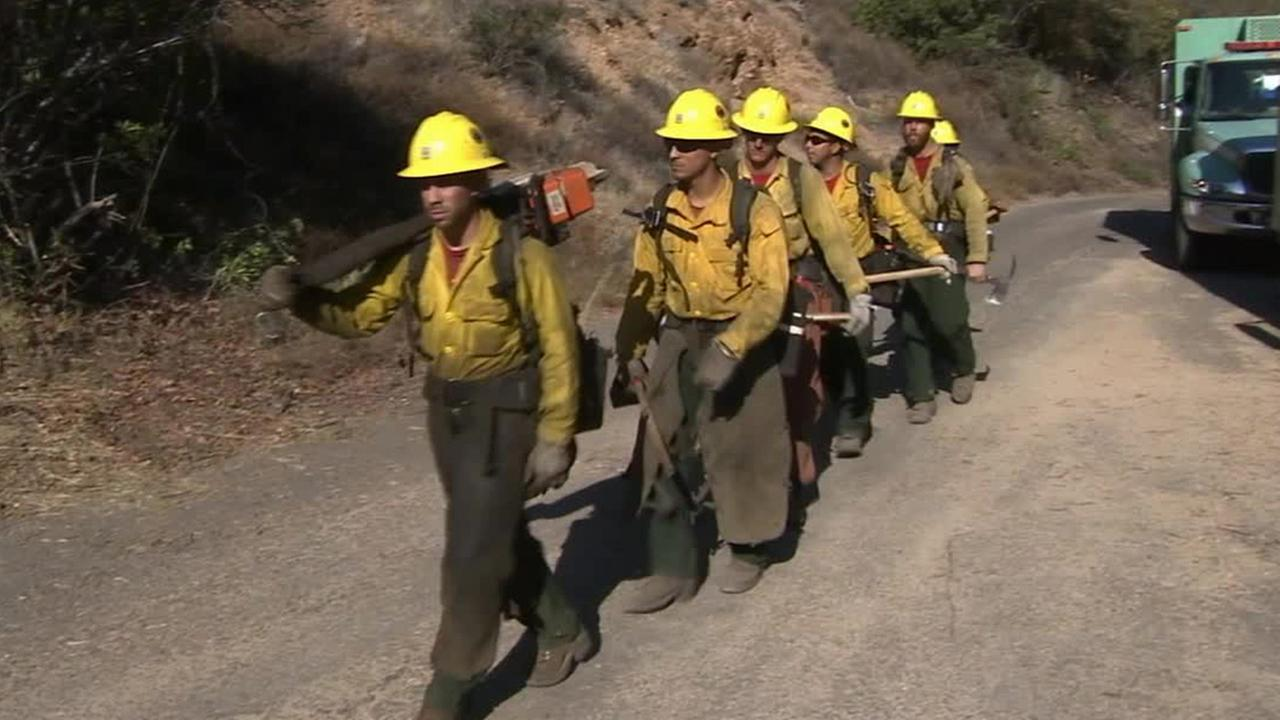 Firefighters work to put out the flames from the Silverado Fire at Orange Countys Cleveland National Forest.