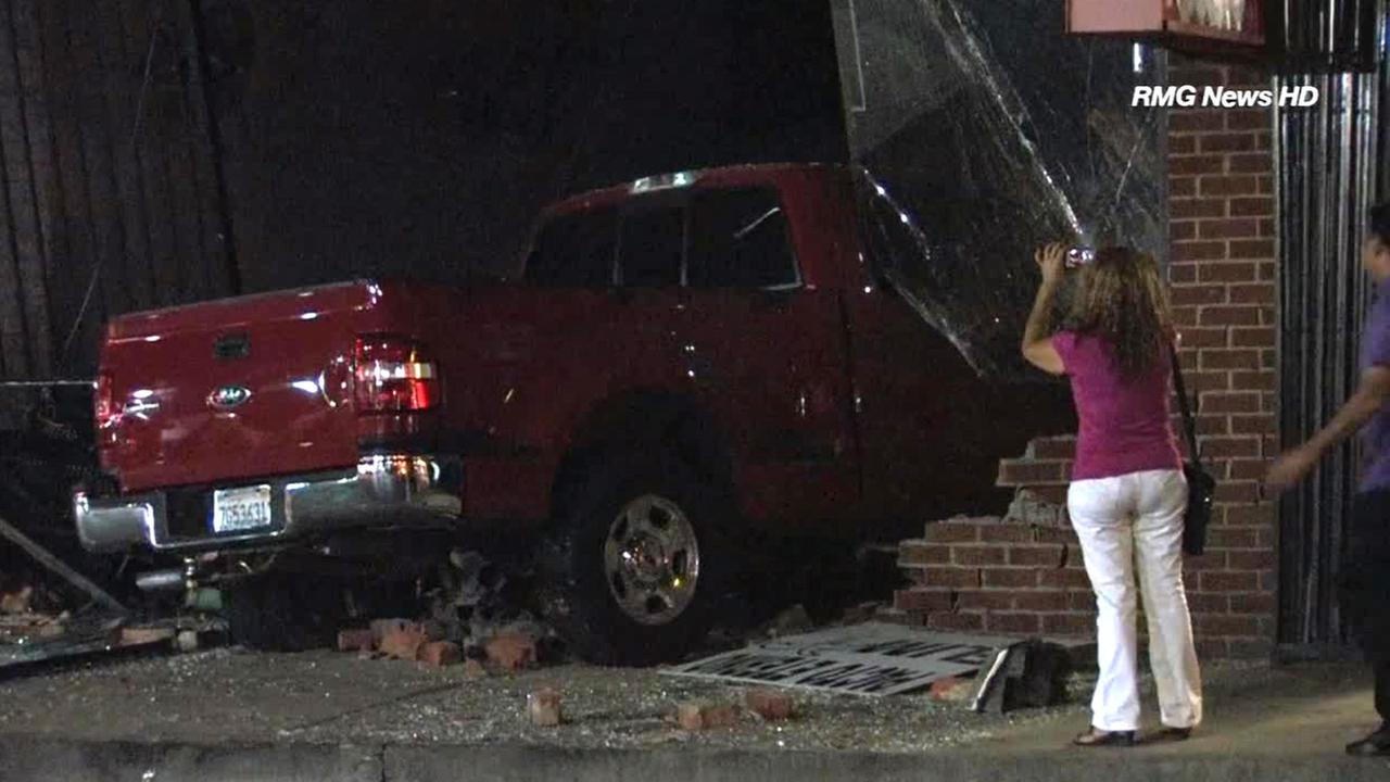 A pick-up truck trying to flee from an accident crashes into a church in Panorama City on Saturday, Sept. 13, 2014.