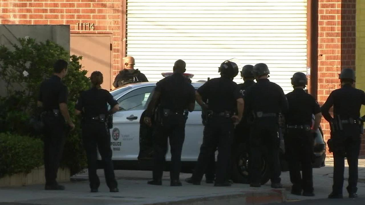 Police surround a medical marijuana dispensary in West Los Angeles, where a burglary was reported on Sunday, Sept. 14, 2014.