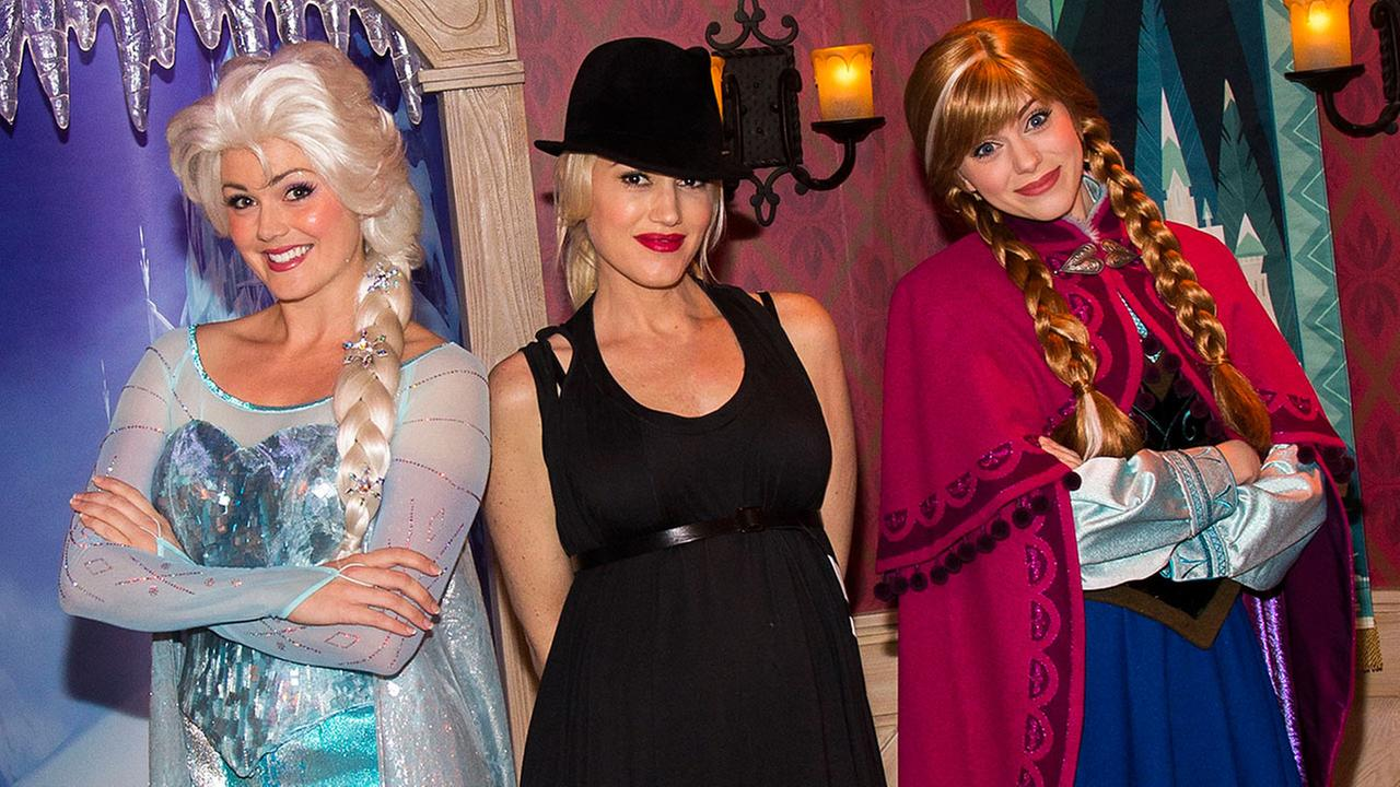 Musician Gwen Stefani, center, posing with women dressed as Elsa the Snow Queen, left, and Anna from the Disney animated film, Frozen, during a visit to Disneyland park in Anahei