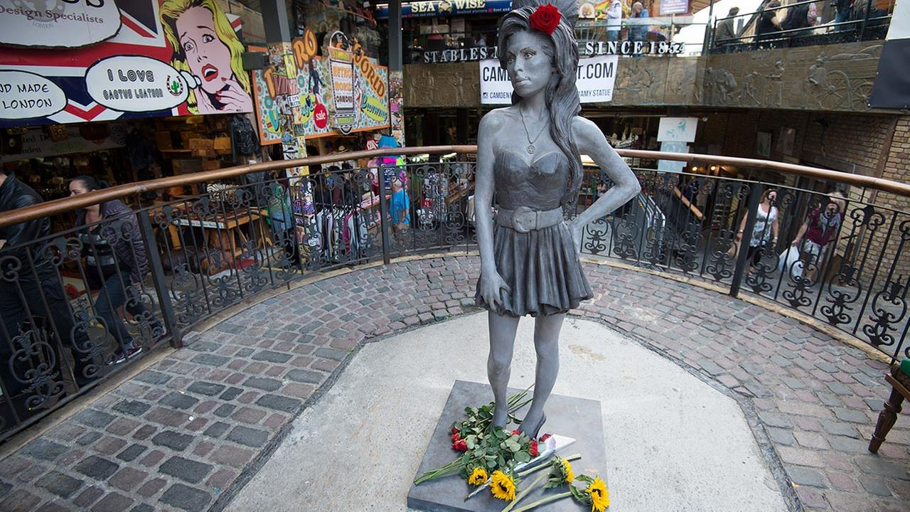 A new statue of the late singer Amy Winehouse after it was unveiled in Camdens Stables Market, in London, England, Sunday, Sept. 14, 2014.