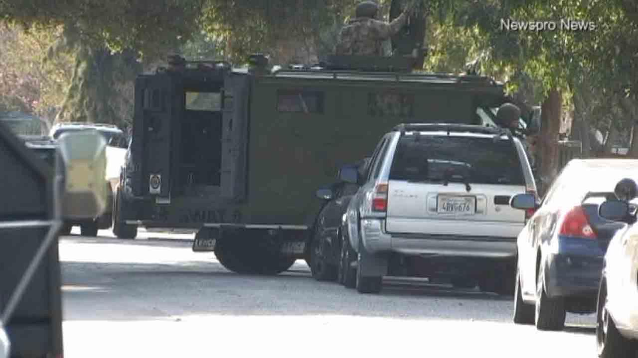 San Bernardino police respond to a barricade situation following a shooting in the 700 block of West 19th Street Sunday, Sept. 14, 2014.