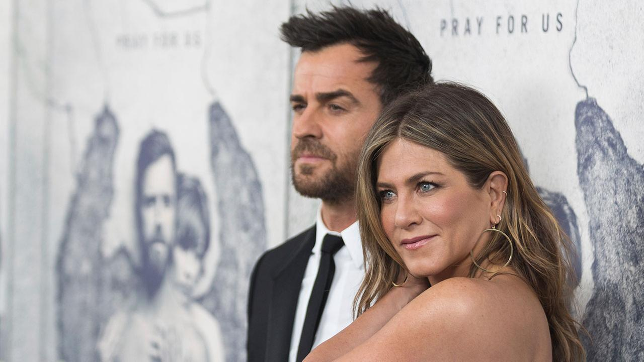 Jennifer Aniston, right, and Justin Theroux arrive at the LA Premiere of The Leftovers Season Three at Avalon Hollywood on Tuesday, April 4, 2017, in Los Angeles.