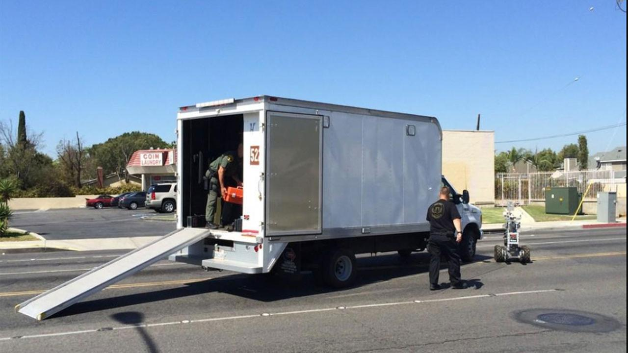 A bomb squad responded to Katella and Western avenues in Stanton Monday, Sept. 15, 2014, after a bank robbery suspect said he had explosives in his vehicle.