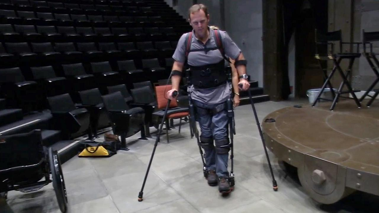 Army veteran Gary Linfoot tries out his exoskeleton, which helps him walk, at the Innovation Summit in Lake Forest on Monday, Sept. 15, 2014.