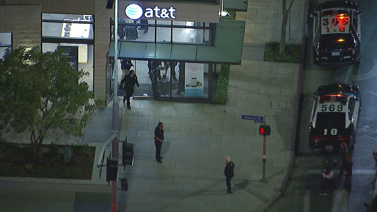 Two LAPD officers were being treated for bite wounds Monday night after responding to a holdup alarm at Tarzana AT&T store.