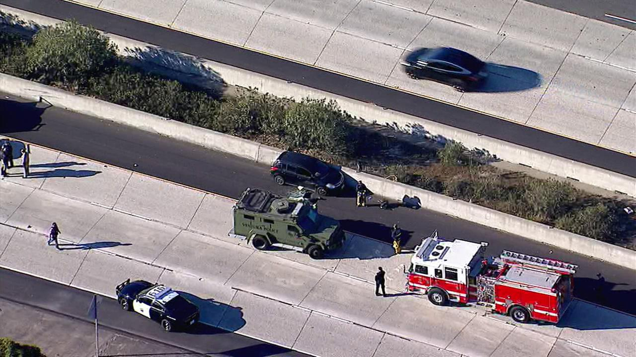 A firefighter covered a suspects body on the 101 Freeway in Ventura after a pursuit involving the California Highway Patrol on Wednesday, Feb. 21, 2018.