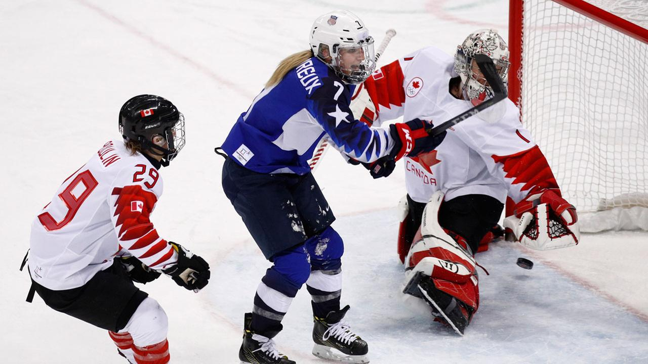 Monique Lamoureux-Morando, of the United States, shoots the puck for as goal during the womens gold medal hockey game at the 2018 Winter Olympics in Gangneung, South Korea.