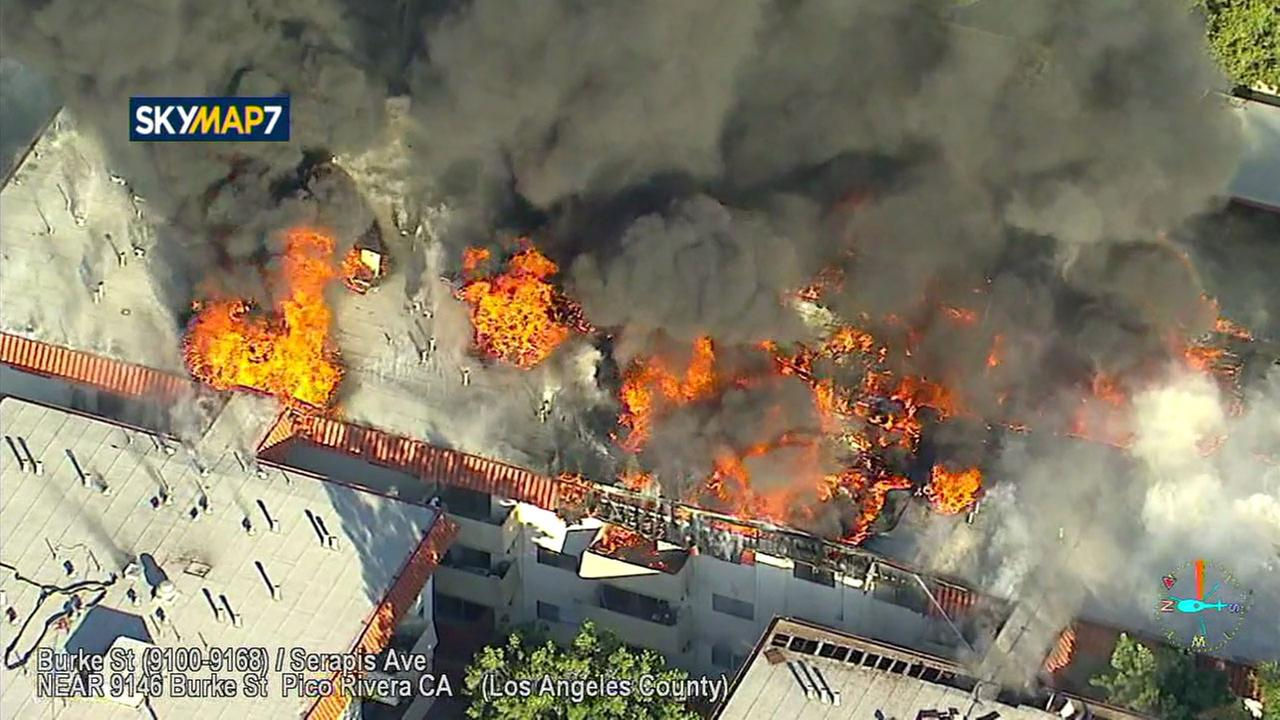 A massive fire ripped through an apartment building and caused the roof to partially collapse in some areas in Pico Rivera on Thursday, Feb. 22, 2018.