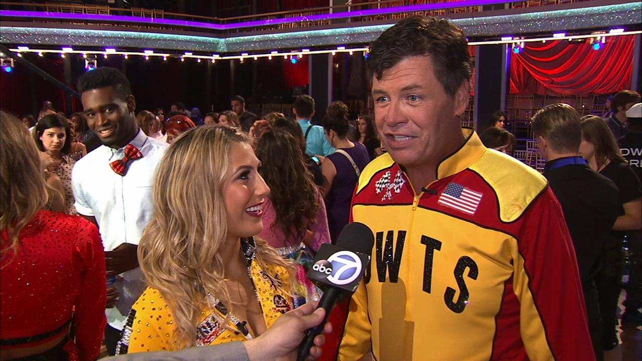 Michael Waltrip and partner Emma Slater talk after the first elimination on Dancing With The Stars Season 19 on Tuesday, Sept. 16, 2014.