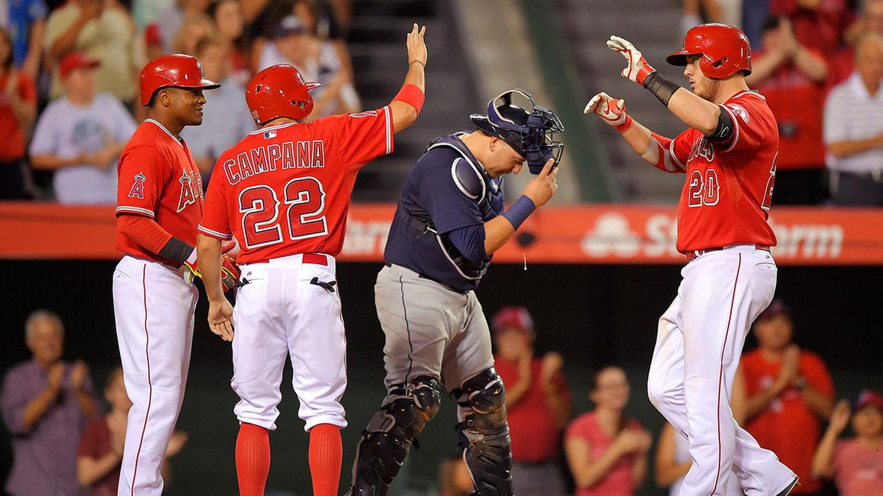 Los Angeles Angels C.J. Cron, right, is congratulated by Erick Aybar, left, and Tony Campana, second from left, after hitting a three-run home run Wednesday Sept. 17, 2014.