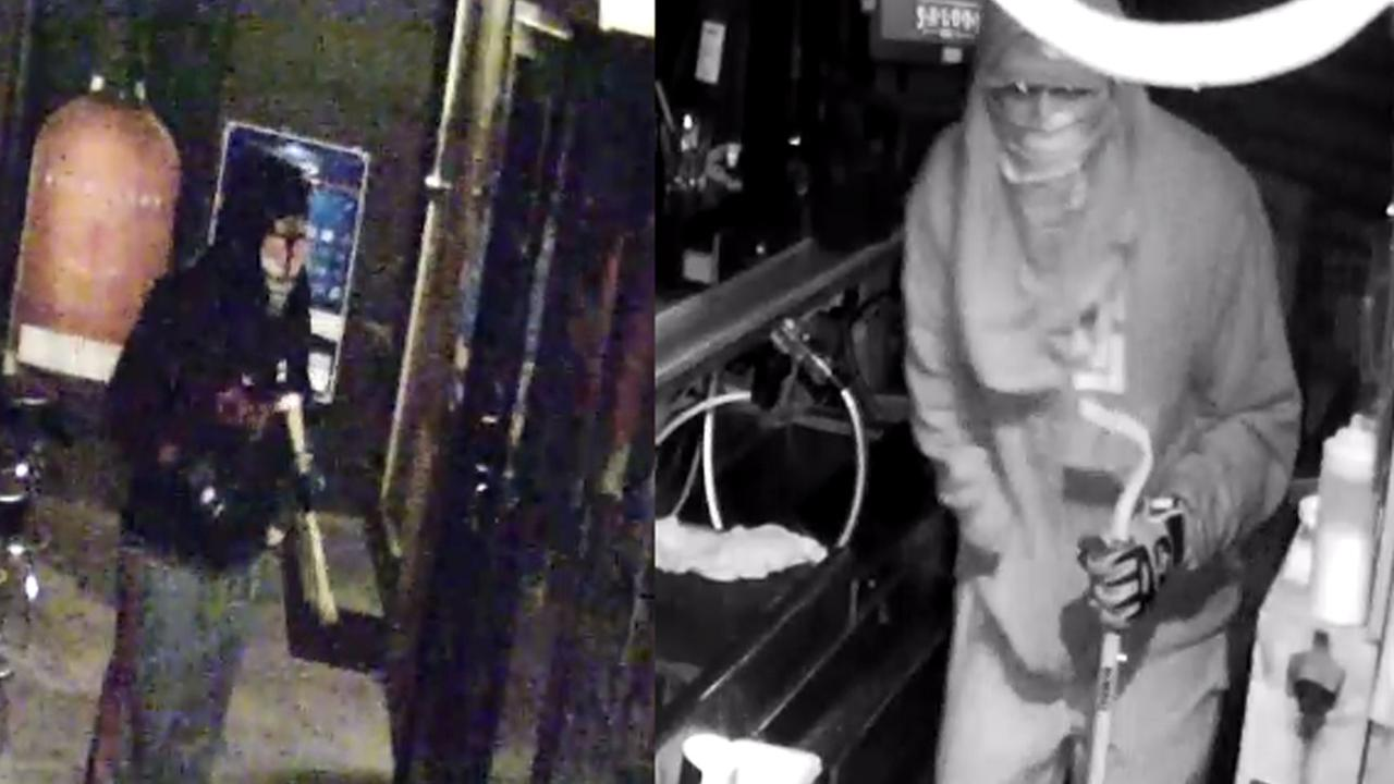 Two suspects are seen on surveillance during a burglary at the Maverick Saloon in Norco on Tuesday, Sept. 16, 2014.