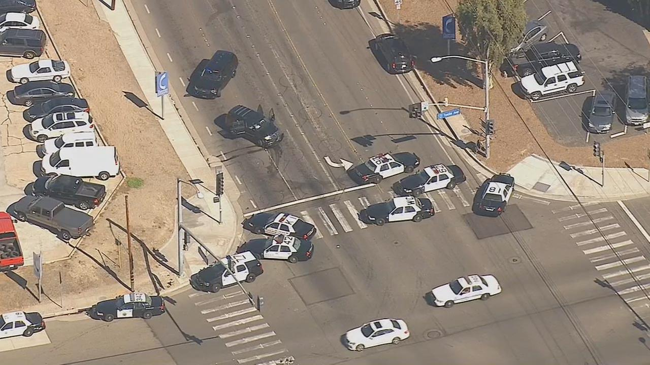 An armed suspect was at large in Anaheim after robbing a Frys Electronics and crashing a getaway vehicle Friday afternoon, Sept. 19, 2014.