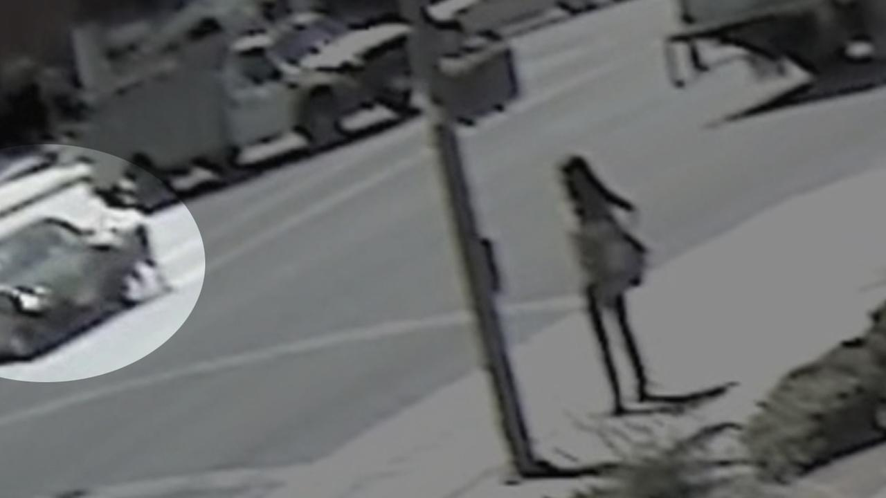 A black sedan crashes into an elderly woman in Glendale on the left side of this screen grab from surveillance video on Thursday, Sept. 18, 2014.