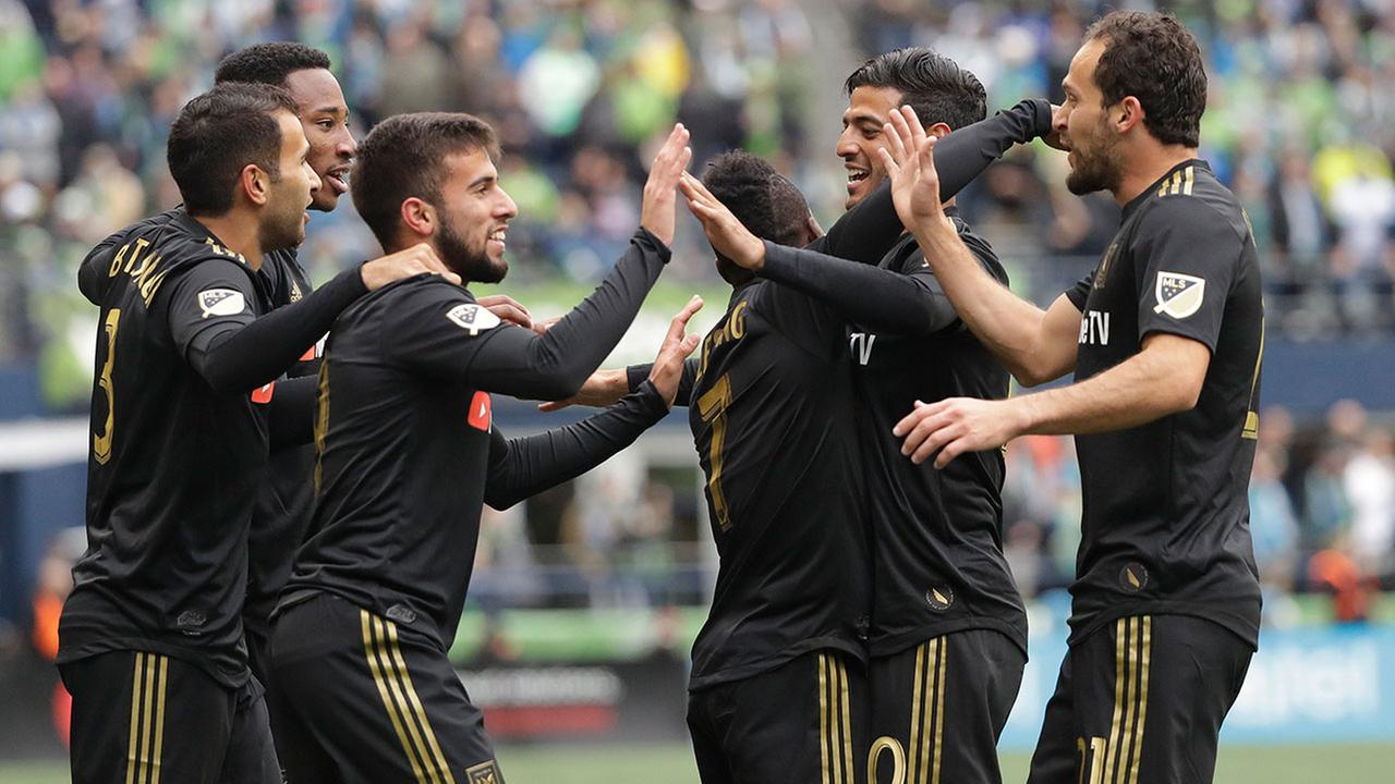 LA FC forward Diego Rossi, third from left, celebrates with teammates after scoring against the Seattle Sounders on Sunday, March 4, 2018, in Seattle.