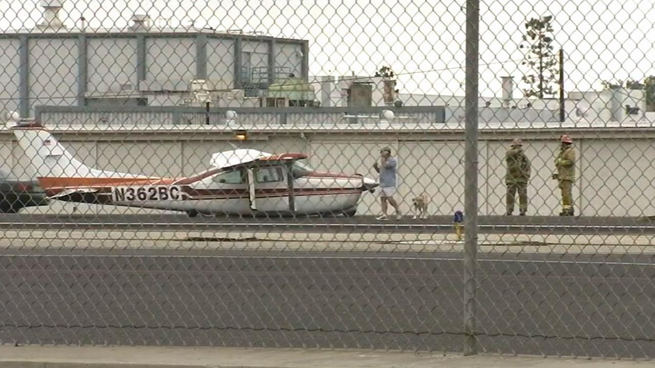 A small plane is seen after it made a hard landing at Hawthorne Airport on Sunday, Sept. 21, 2014.