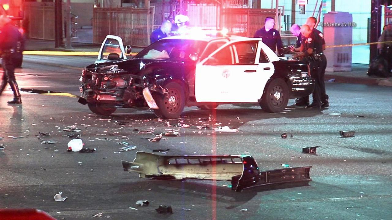An LAPD cruiser is seen after an officer was injured in a crash in West Adams on Sunday, Sept. 21, 2014.