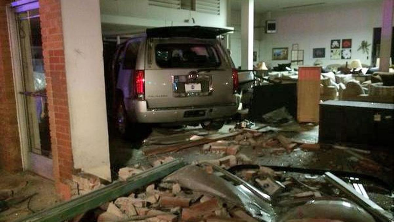 Suspects in a stolen SUV crashed into a furniture store in Fullerton on Tuesday, Sept. 23, 2014.