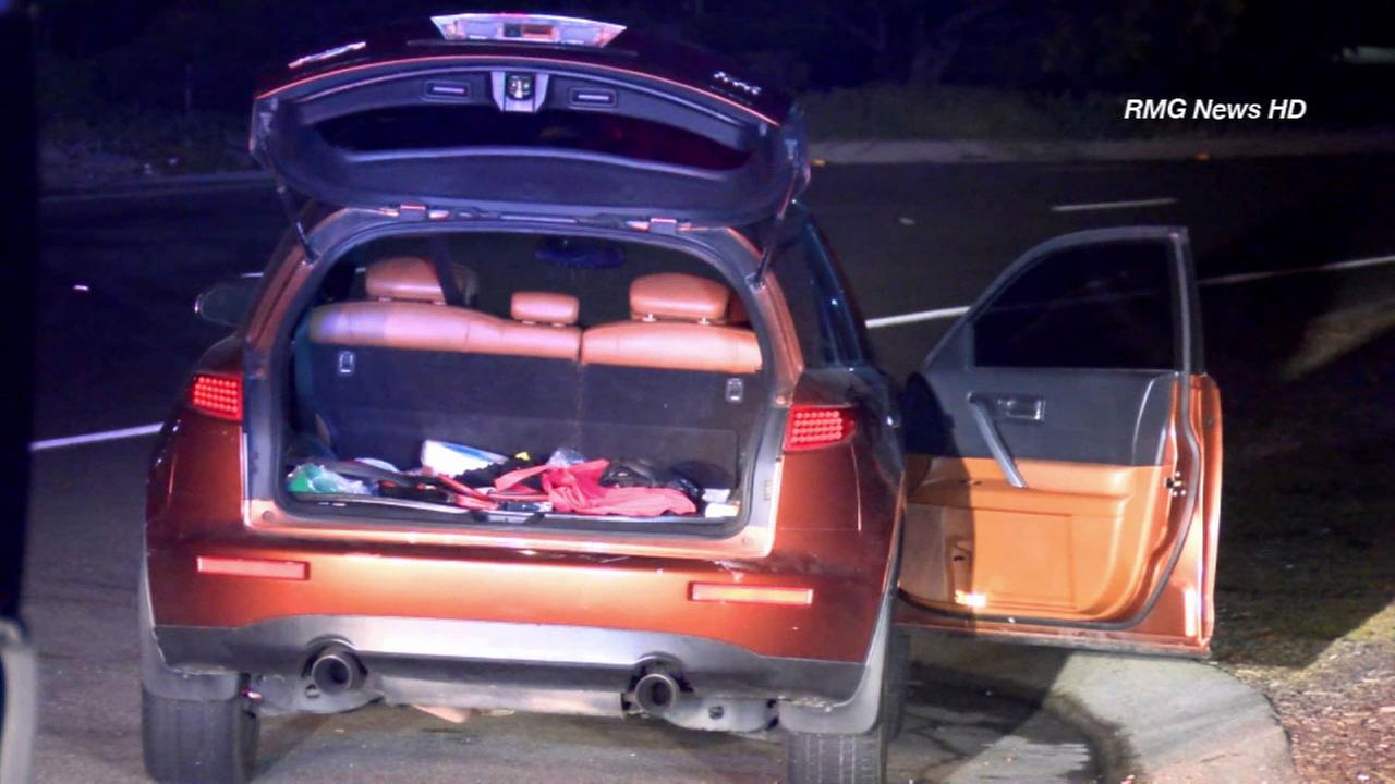 Police investigate after a woman was found tied up in the trunk of an SUV in Pomona on Monday, Sept. 22, 2014.