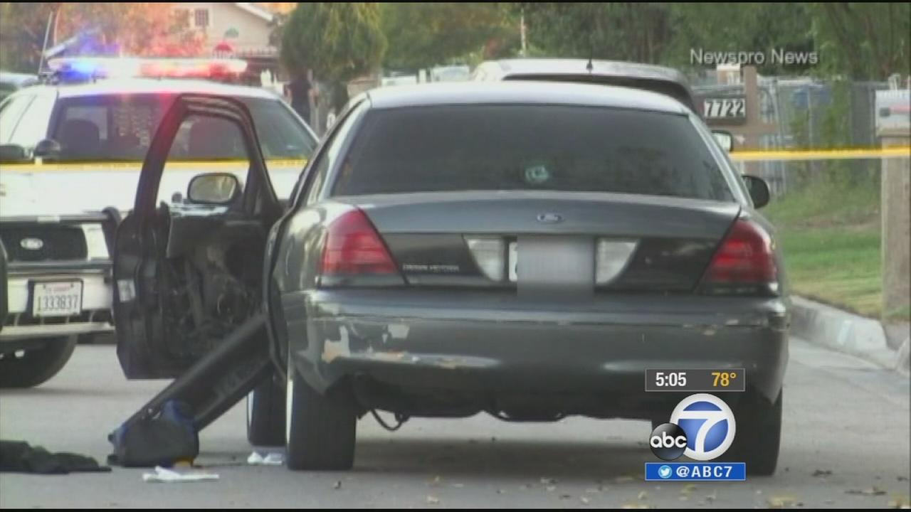 A man and his 3-year-old son were wounded when a vehicle pulled up to them and opened fire in Highland Monday, Sept. 22, 2014.
