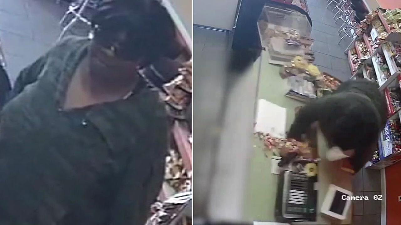 An armed robbery suspect wearing a wig is shown in surveillance video when she was nearly crushed by a convenience store counter in South Los Angeles.