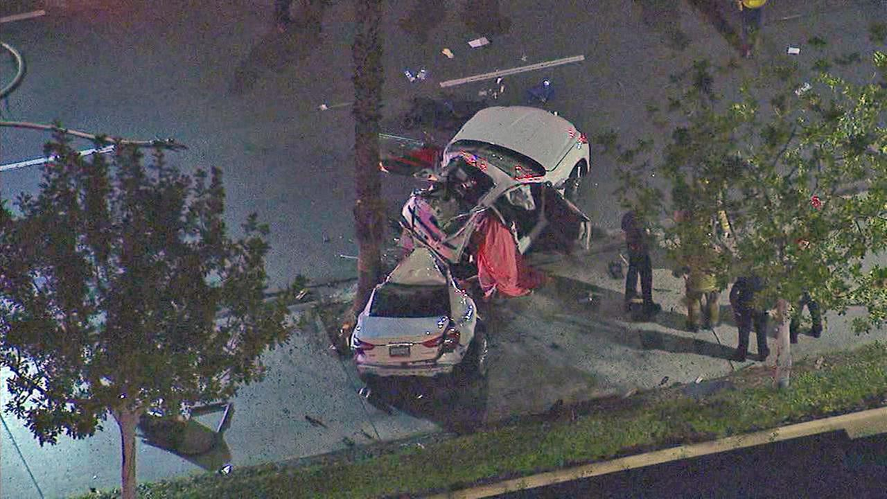 At least one person was dead after a violent single-car crash in Long Beach Friday, March 16, 2018.