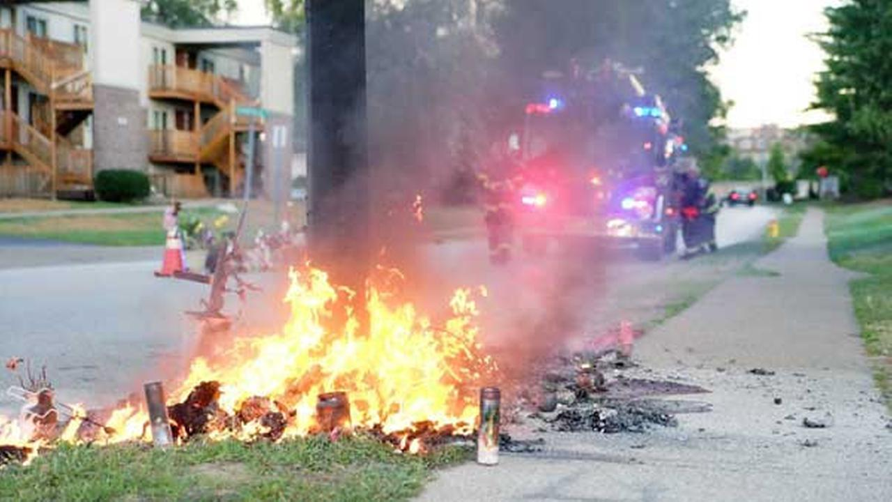 A fire burns at a memorial in Ferguson, Mo., on the site where a Missouri police officer fatally shot 18-year-old Michael Brown.